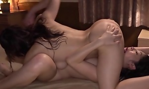 Two insatiable Asian lesbians fucking passionately on touching bed