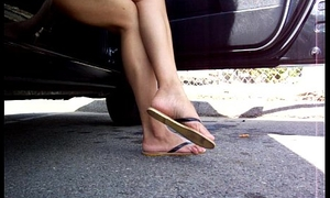 latina salvadorian sexy legs and sandal dangle