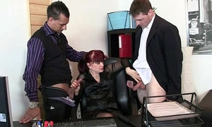 Office bitch swallows a handful of dicks