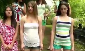 Lesbian cosh humiliates nude teens outdoors