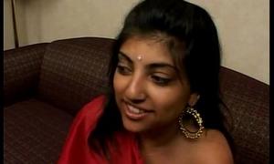 Indian Woman adjacent to Red Saree