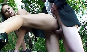 Outdoor lovemaking scene with a blonde