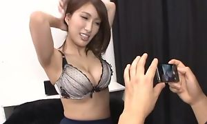 Busty Asian chick teases boyfriend upon the brush juicy melons