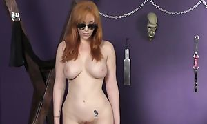 Flexible redhead chick fucks herself with flashing toy