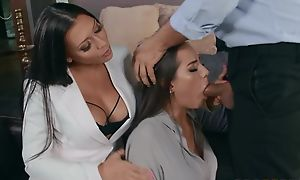 Twosome glamorous brunettes pleasuring Keiran in bed