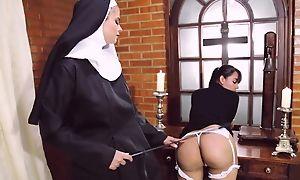 Perverted nun fucks her girlfriend about strapon dildo